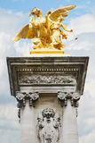 Alexandre III bridge golden statue in Paris Royalty Free Stock Image