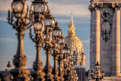 Alexandre III bridge with Invalides in Paris, France Stock Images