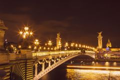 Alexandre III Bridge at night in Paris royalty free stock image