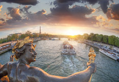 Alexandre III bridge in Paris against Eiffel Tower with boat on Seine, France Royalty Free Stock Photos