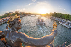 Alexandre III bridge in Paris against Eiffel Tower with boat on Seine, France Royalty Free Stock Photography