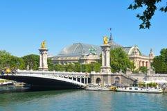 Alexandre III bridge in Paris. Paris, France - July 9, 2015: View of the The Pont Alexandre III, a deck arch bridge that connects the Champs-Élysées quarter Stock Photo