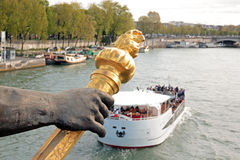 Alexandre III bridge, the torchbearer and tourist boat (Paris, France) Royalty Free Stock Image