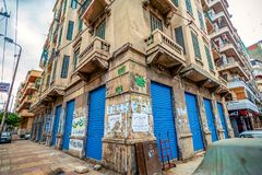 11.16.2018 Alexandria, Egypt, Kind of a corner of an old house with bright and blue doors flooded with old advertisements. On a cloudy day stock photos