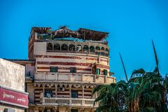 11.16.2018 Alexandria, Egypt, view of an old and abandoned building in the center of Alexandria against the background of a blue s royalty free stock photography