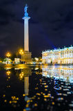 The Alexandrian Pillar on Palace Square the night of St. Petersburg, reflections in puddles. Hermitage Royalty Free Stock Photos