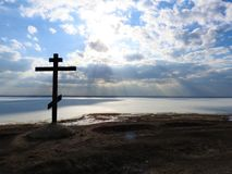 Alexandrov mountain in Pereslavl, the cross and a fabulous view of the lake in the ice in winter, the blue sky clouds royalty free stock image