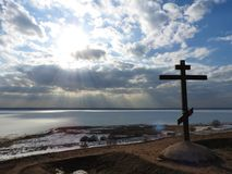 Alexandrov mountain in Pereslavl, the cross and a fabulous view of the lake in the ice in winter, the blue sky clouds stock photo