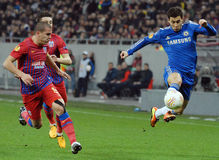 Alexandru Bourceanu and Eden Hazard. Alexandru Bourceanu of Steaua Bucharest and Eden Hazard of Chelsea London pictured in action during the Europa League game Royalty Free Stock Photo