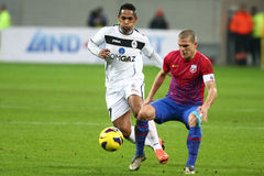 FC Steaua Bucharest- FC Gaz Metan Medias. Alexandru Bourceanu (R), Eric de Oliveira (L) fighting for the ball, during the football match, counting for the Royalty Free Stock Image