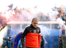 Alexandru Bourceanu reacts while Steaua Bucharest footbal fans c Stock Photo