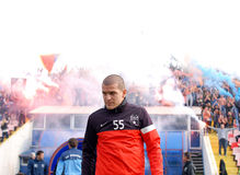 Alexandru Bourceanu reacts while Steaua Bucharest footbal fans c Royalty Free Stock Photos