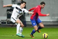 FC Steaua Bucharest- FC Gaz Metan Medias. Alexandru Chipciu (R), Azdren Llullaku (L) fighting for the ball, during the football match, counting for the Romanian Stock Images