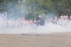 Alexei Kalinin burns down tires on of motorcycle moto show Stock Image