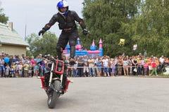 Alexei Kalinin rides standing on a motorbike. Moto show in Verkhovazhye, Vologda region, Russia Stock Photos