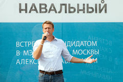 Alexey Navalny against a banner with an inscription Navalny Royalty Free Stock Photography