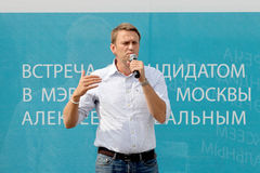 Alexey Navalny against a propaganda board Royalty Free Stock Photography