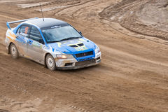 Alexey Semenov drives a blue Mitsubishi Lancer Stock Photography