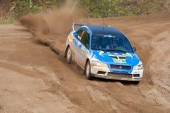 Alexey Semenov drives a blue Mitsubishi Lancer Stock Photography
