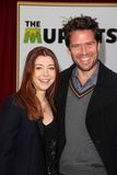 Alexis Denisof, Alyson Hannigan,. Alyson Hannigan, Alexis Denisof  at The Muppets World Premiere, El Capitan Theater, Hollywood, CA 11-12-11 Royalty Free Stock Photography