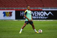 Alexis Sanchez. KUALA LUMPUR - AUGUST 09: Barcelona Football Club player Alexis Sanchez warms up during training session at the Bukit Jalil National Stadium on Stock Photography
