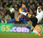 Alexis Sanchez vies with Jordi Alba Stock Images