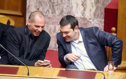 Alexis Tsipras talks with Finance Minister Yanis Varoufakis. ATHENS, GREECE - FEBRUARY 18,2015: Prime Minister Alexis Tsipras (R) talks with Finance Minister Stock Photography