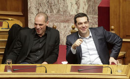 Alexis Tsipras talks with Finance Minister Yanis Varoufakis Royalty Free Stock Photography