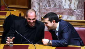 Alexis Tsipras talks with Finance Minister Yanis Varoufakis Royalty Free Stock Image