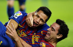 Alexis and Xavi of FC Barcelona. Alexis Sanchez(L) and Xavi Hernandez(R) of FC Barcelona celebrate goal during the spanish league match against Rayo Vallecano at Stock Photography