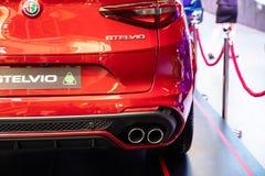 Alfa metálica roja Romeo Stelvio del coche del color imágenes de archivo libres de regalías