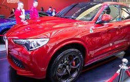 Alfa metálico vermelho Romeo Stelvio do carro da cor imagens de stock royalty free