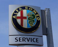 Alfa Romea. Brand and logo of car manufacturer Alfa Romea on a sign at a car dealer garage Royalty Free Stock Images