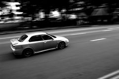 Alfa Romeo. Panning shot of an Alfa Royalty Free Stock Photography