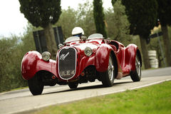 Alfa Romeo 6C 2300. An Alfa Romeo 6C 2300 attends the 26th edition of Camucia Cortona, a competition race of hill-climb for hsitorical cars valid for CSAI Royalty Free Stock Photo