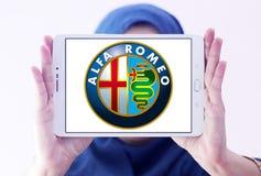 Alfa romeo car logo. Logo of alfa romeo car brand on samsung tablet holded by arab muslim woman royalty free stock images