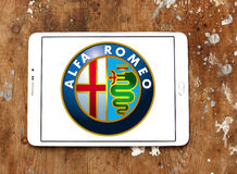 Alfa romeo car logo. Logo of alfa romeo car brand on samsung tablet on wooden background Stock Images