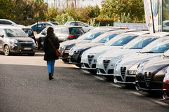 Alfa Romeo   car store. PARIS, FRANCE - OCT 10, 2015: Woman walking between rows of new car to choose the most precious one at the Alfa Romeo car store Royalty Free Stock Photography