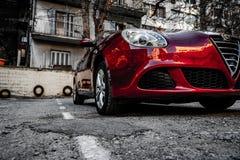 Alfa Romeo Giuletta, colore rosso scuro, lavato e lucidato immagine stock