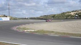 Alfa Romeo race cars on track stock video