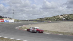 Alfa Romeo race cars on track stock video