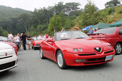 Alfa romeo spider in alfa old and new on road Royalty Free Stock Image