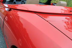 Alfa romeo spider rear fender detail. Rear left fender detail close up. 1990s red alfa romeo spider sports car at 2012 fiat freak out event in virginia Stock Photos