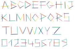 Alfabet av kulöra blyertspennor Arkivfoton