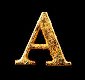 Alfabet en aantallen in bladgoud royalty-vrije stock foto's