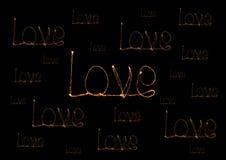Alfabet för ljus för förälskelsetomteblossfyrverkeri Royaltyfria Bilder