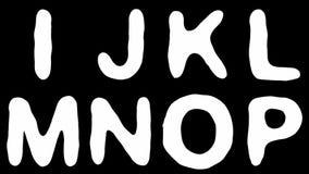 Alfabet från ormhud som isoleras på svart bakgrund arkivfilmer