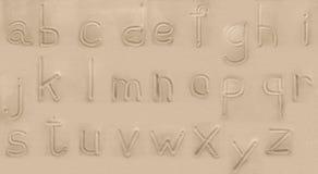 Alfabet från sanden. Arkivbilder