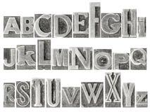 Alfabet in gemengd metaaltype dat wordt geplaatst Stock Foto's