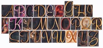 Alfabet i dekorativ wood typ Arkivbild
